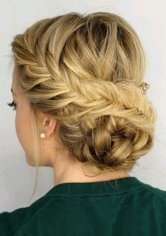 a fishtail side braided updo with a braided bun and some locks down