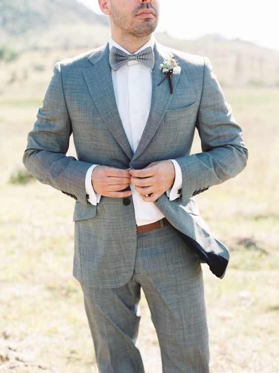 a grey printed tuxedo plus a grey bow tie is a fresh take on a traditional look