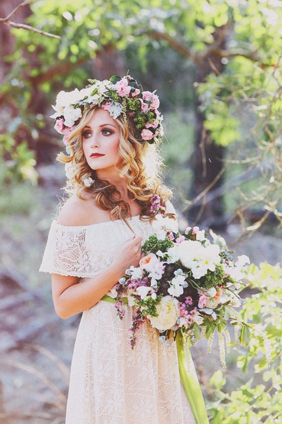 a lush floral crown with pink and white blooms and much greenery plus a matching bouquet for a summer bride