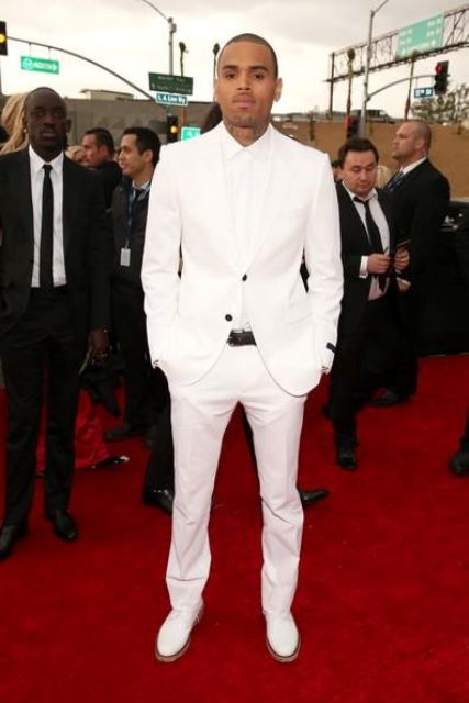a wow look with a white suit, a white shirt, white shoes, a black belt and buttons
