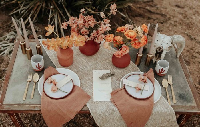 Copper candle holders, skulls, textural fabric are ideal for a boho desert table setting