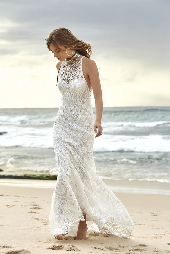 Star Gazer wedding dress with a fitted underdress, an illusion halter neckline and a slight mermaid touch