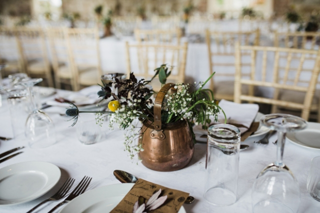 The centerpieces were done with copper vases and pots for a beautiful vintage look