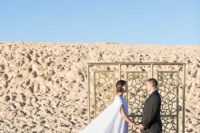10 The wedding backdrop was a gold laser cut one placed in the desert