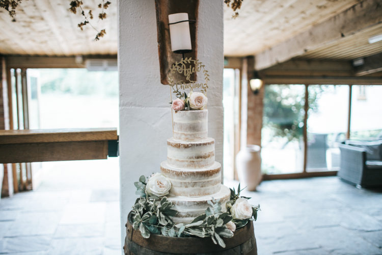 The wedding cake was a naked one, with fresh blooms and a calligraphy topper