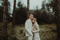 10 a white suit, a white tie, brown shoes for a moody woodland elopement