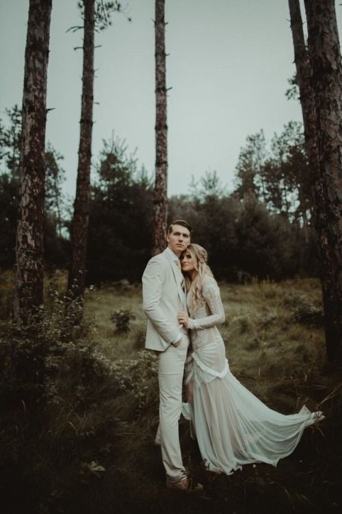 a white suit, a white tie, brown shoes for a moody woodland elopement