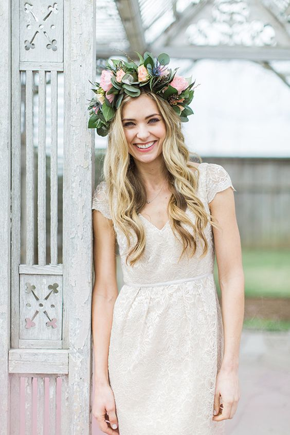 an oversized floral crown with pink blooms and much foliage for a summer bridal look