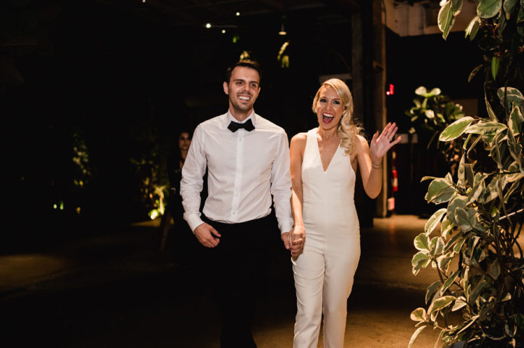 The bride changed for a white jumpsuit for the reception