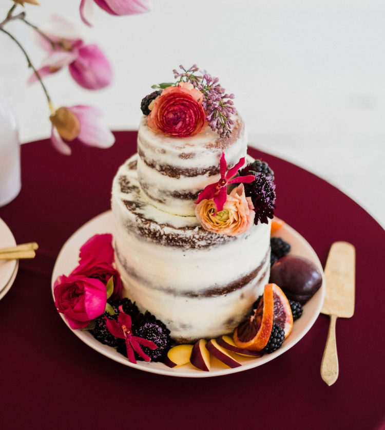 The wedding cake was a naked one, with fresh blooms and fruits that were bold touches