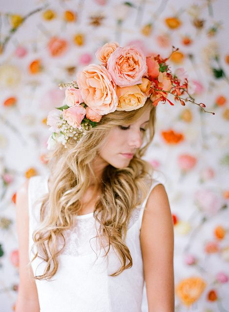 a large romantic floral crown of blush, orange and pink blooms plus some baby's breath
