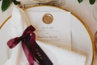 11 a stylish table setting with touches of gold, burgundy and lots of greenery for a fresh look