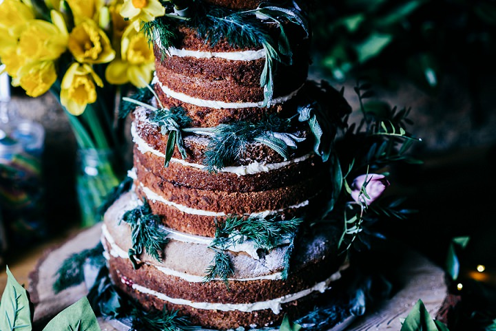 The wedding cake was a naked one, decorated with greenery and blooms to fit the fresh and cozy style
