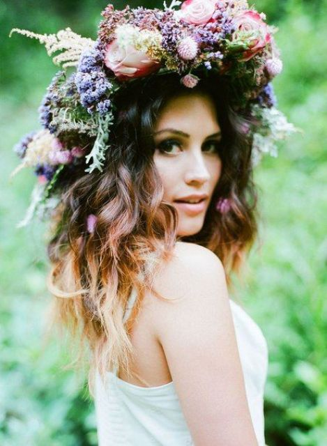 a lush floral crown with wildflowers, herbs and berries for a wild summer boho bride