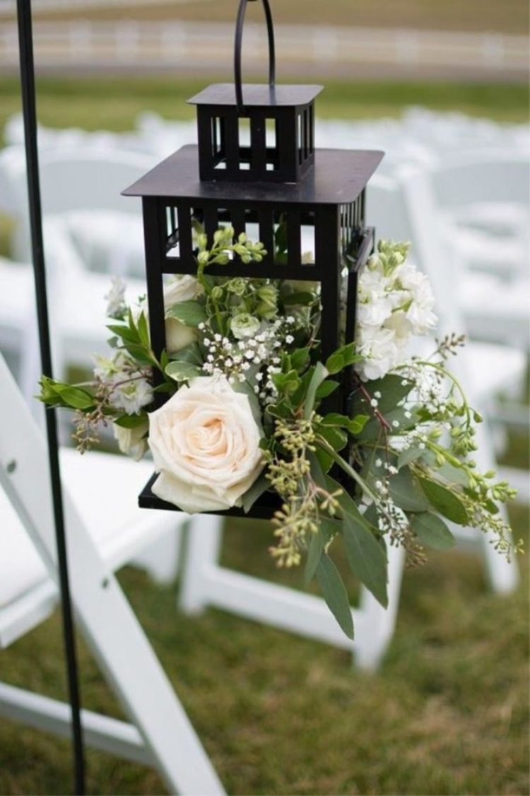 Borrby lantern is turned into a wedding aisle decoration with lush flowers and greenery