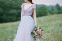 13 a lavender wedding gown with an embellished V-neckline, short sleeves and a light layered skirt