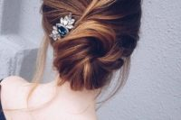 13 a messy twisted low chignon hairstyle with some bangs and a large hairpiece on one side for a relaxed look