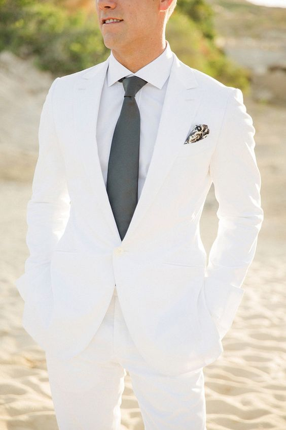 a white groom's suit, a white shirt and a graphite grey tie for a bold summer look