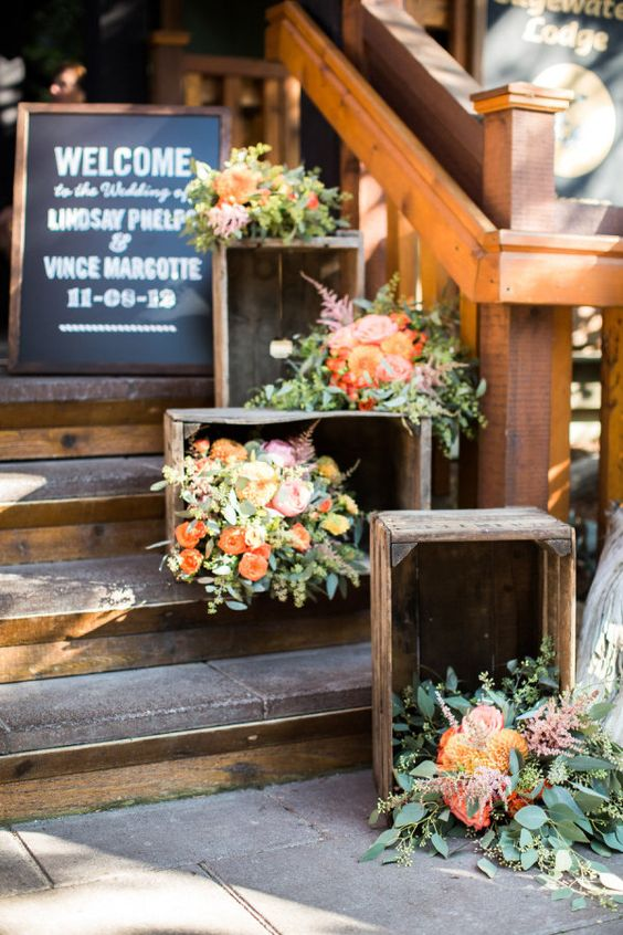 line up the wedding staircase with crates and bright and blush blooms and greenery inside