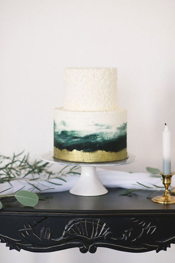 a creative wedding cake with an ombre white to emerald and gold plus a texture