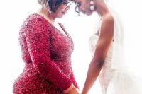 14 a red sequin sheath dress with long sleeves and a V-neckline plus statement earrings