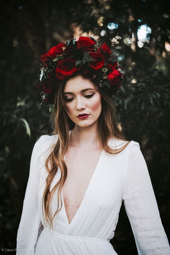 a large moody crown with red roses and dark greenery for a fall boho bridal look