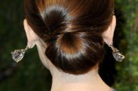 16 a elegant low chignon with a sideswept section is a very durable option for a picture-perfect look