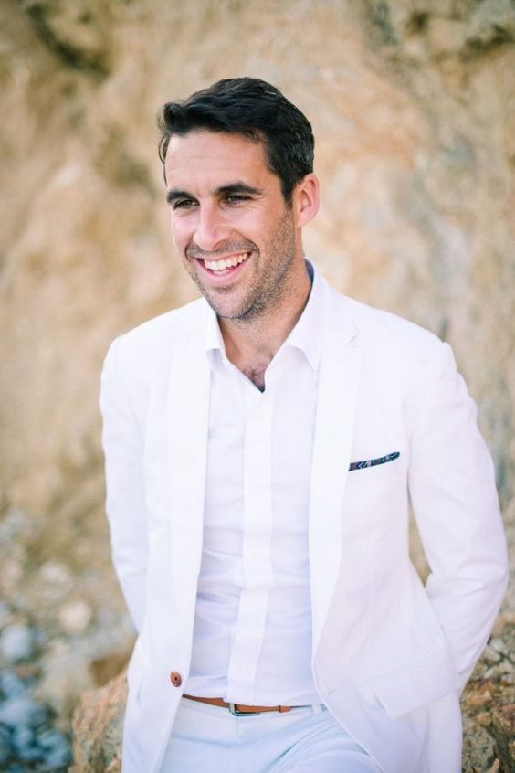 an all white look without a tie plus an amber belt for modern beach groom style