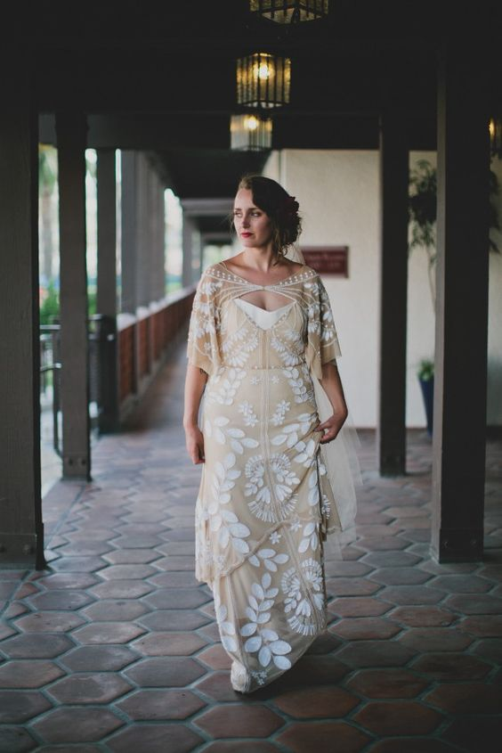 Dahlia gown of a nude shade with botanical white lace appliques, short sleeves and a catchy neckline