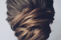 17 a chic low updo with a bump and much volume and texture for a feminine feel