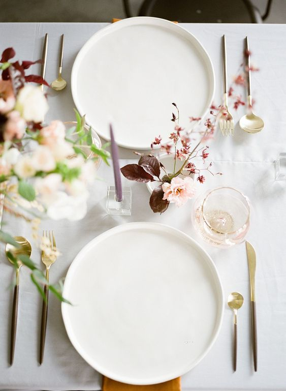 a minimalist fall wedding tablescape in blush, burgundy, green and plum plus lilac candles