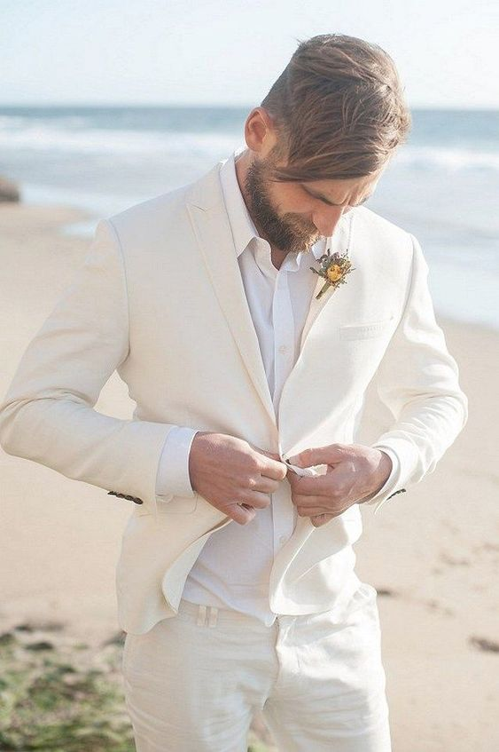 an ivory suit and a white shirt are all you need for an effortlessly chic beach look