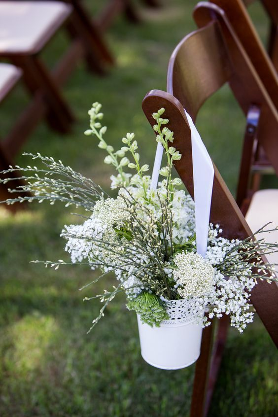 use Skurar pots to line up your wedding aisle with flowers and greenery, it has a perfectly romantic feel