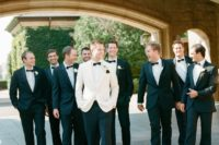 18 a white dinner jacket plus black pants and a black bow tie is a formal and elegant look