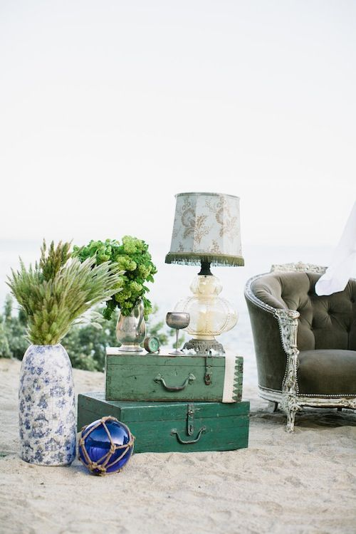 add touches of your wedding style and theme to your lounge, for example, vintage suitcases for a travel-inspired wedding