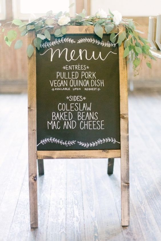 IKEA Mala easel used to make chalkboard wedding signage with fresh eucalyptus
