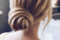 19 a low large bun, much volume and some bangs is a timeless option