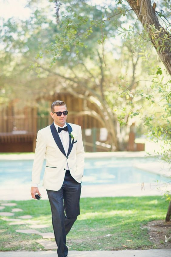 a modern take on a white tuxedo look with black lapels and touches for a cool feel