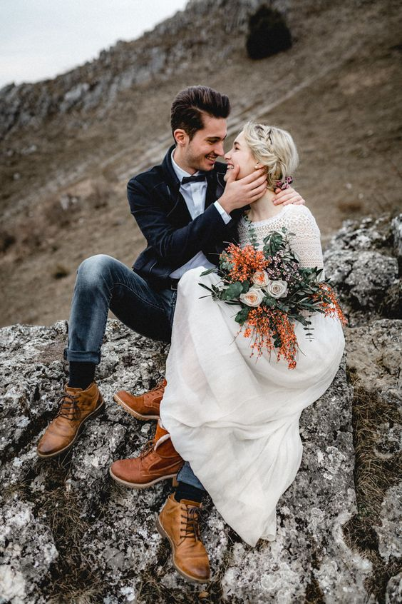 navy jeans, a black velvet jacket, brown shoes, a white shirt and a black bow tie for a textural groom look for a mountain elopement