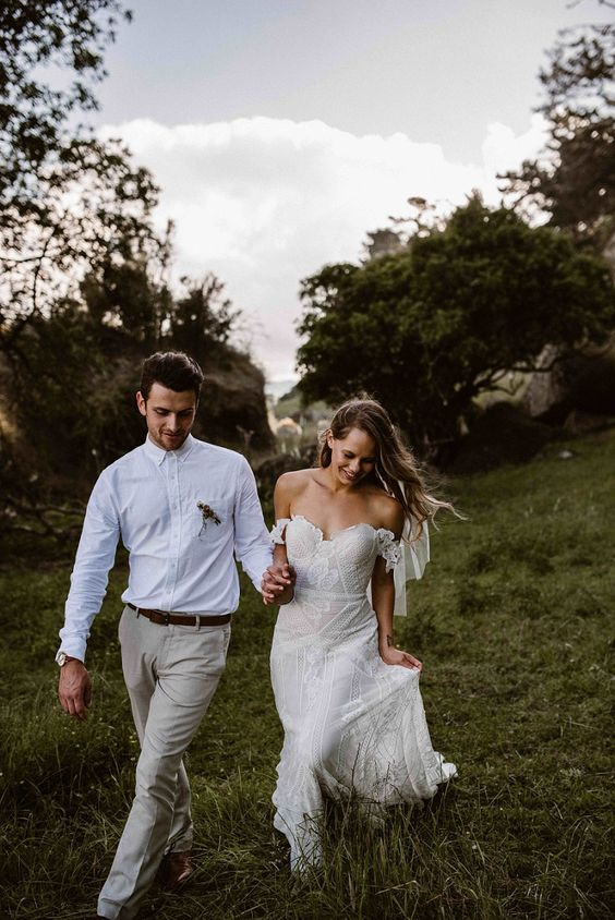 Fox off the shoulder sheath gown of boho lace with floral appliques for a summer bride
