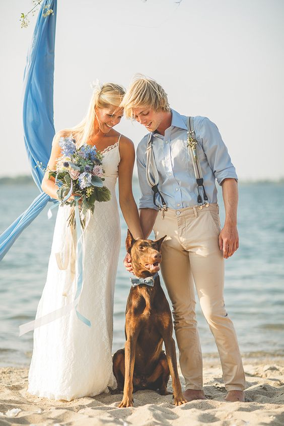 a blue shirt, tan pants and creative suspenders for a boho beach wedding