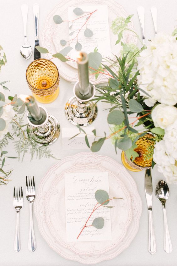 a neutral table setting done with touches of grey and mustard plus fresh greenery