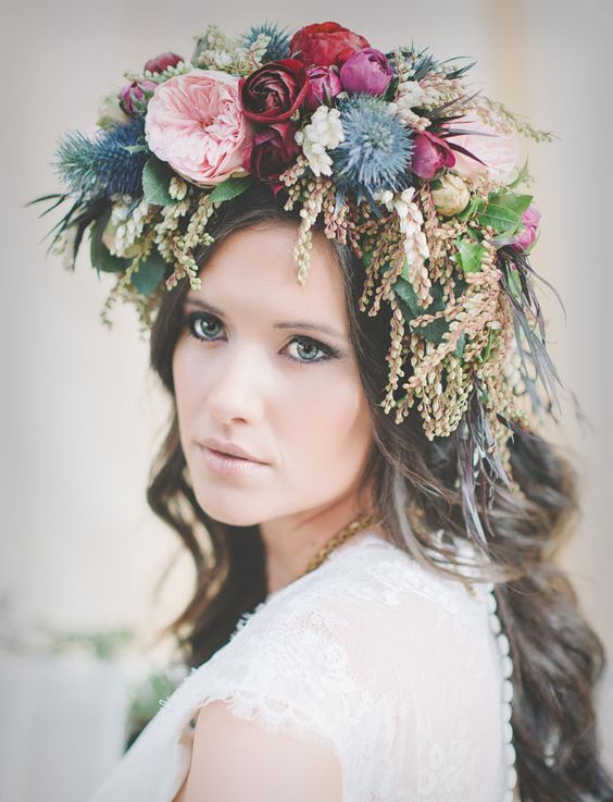 a romantic floral crown with blush peonies, red roses and blue thistles and a texture for a bold look
