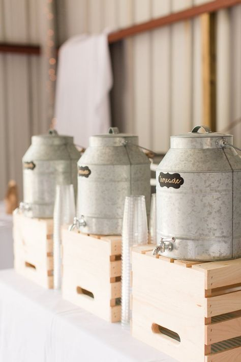 place drink tanks on crates, it's a comfy idea for a rustic wedding