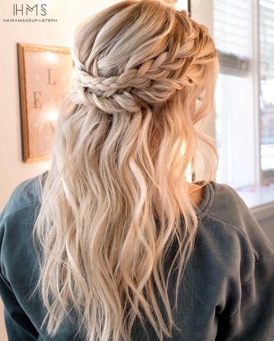 a half updo with a double halo braid and textural hair down for a boho bride