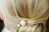21 a super elegnat low twisted bun with a couple of large pearl pins for a timeless look