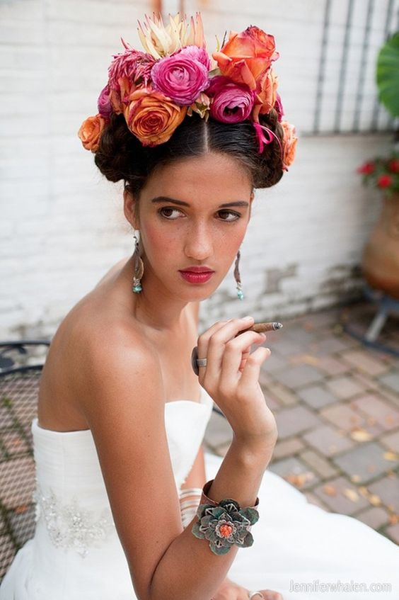 a tropical floral crown with pink, orange blooms and a king protea for a bold look