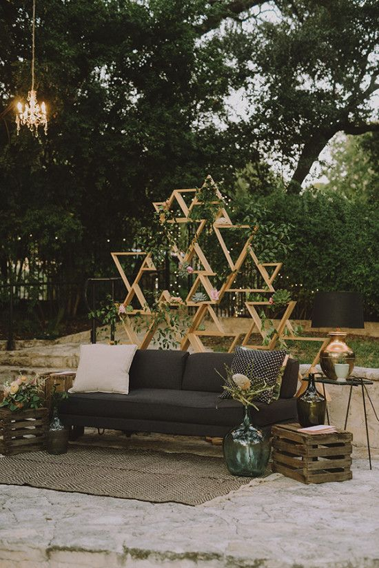 such a geometric backdrop will add to the decor visually separating the space from the rest and making it mor eintimate