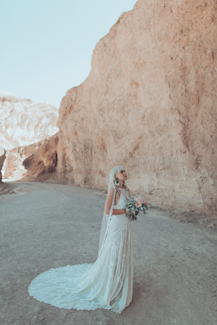 Lilly Jagger lace applique dress with a halter neckline with a cutout and a train for a boho desert bride