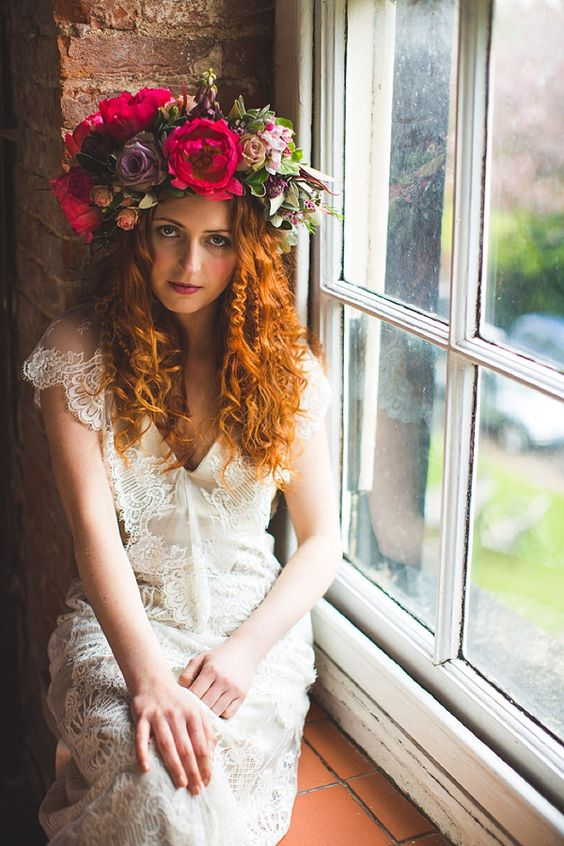 a very lush floral crown with purple and hot pink blooms and some greenery for a summer boho look